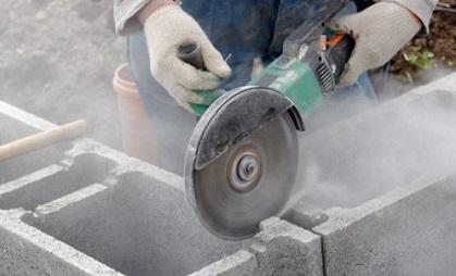Silica dust generated by cutting through bricks